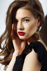 Charisma. Gorgeous Aristocratic Woman with Red Lips